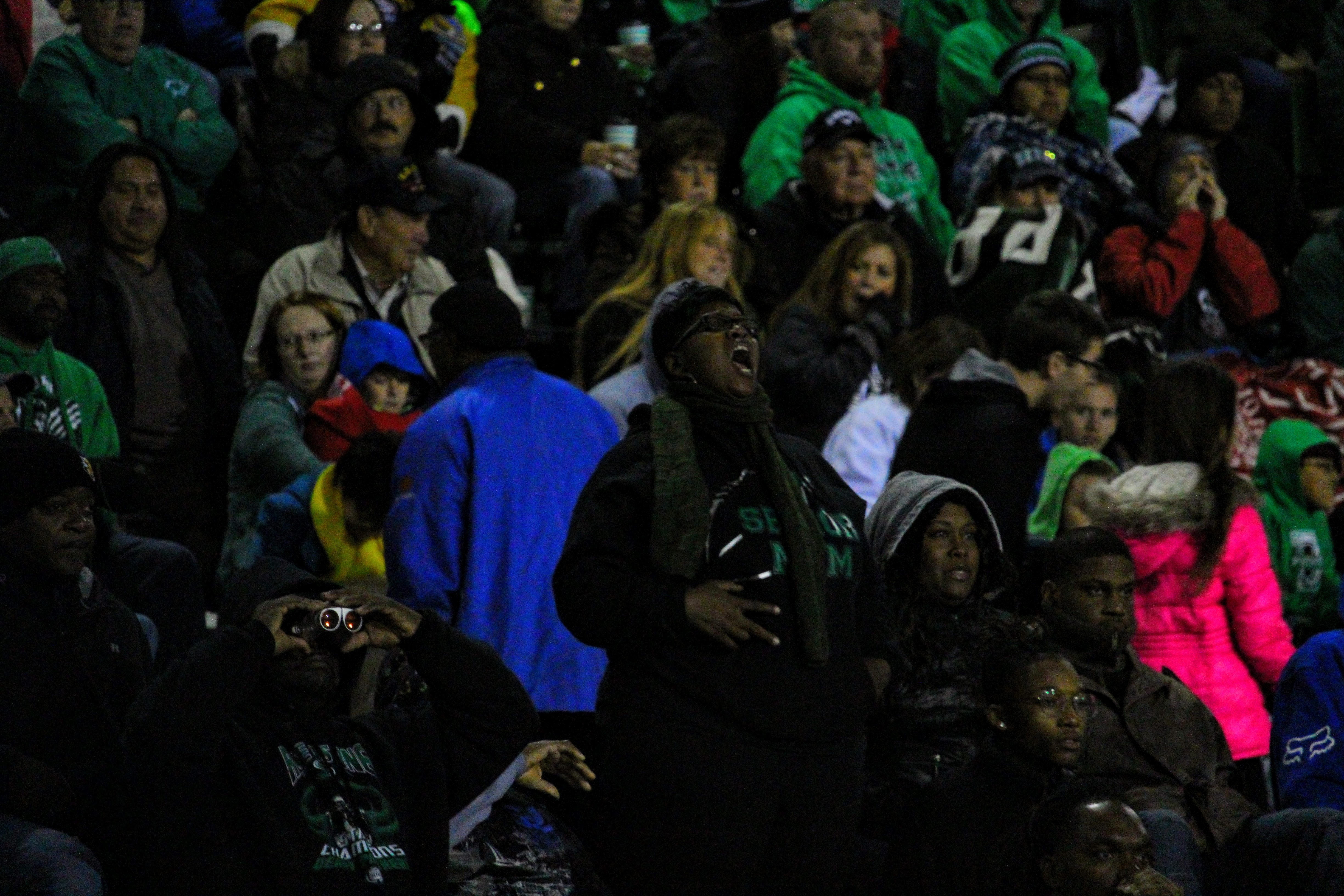 Peerlus Walker's mom hollers from the stands during a home game at Panther Stadium.
