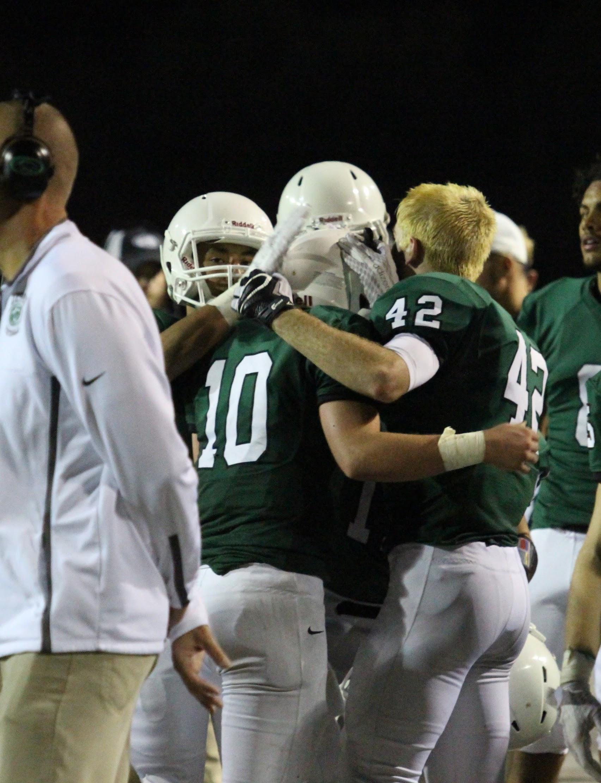 Seniors hug teammate Dan Dawdy