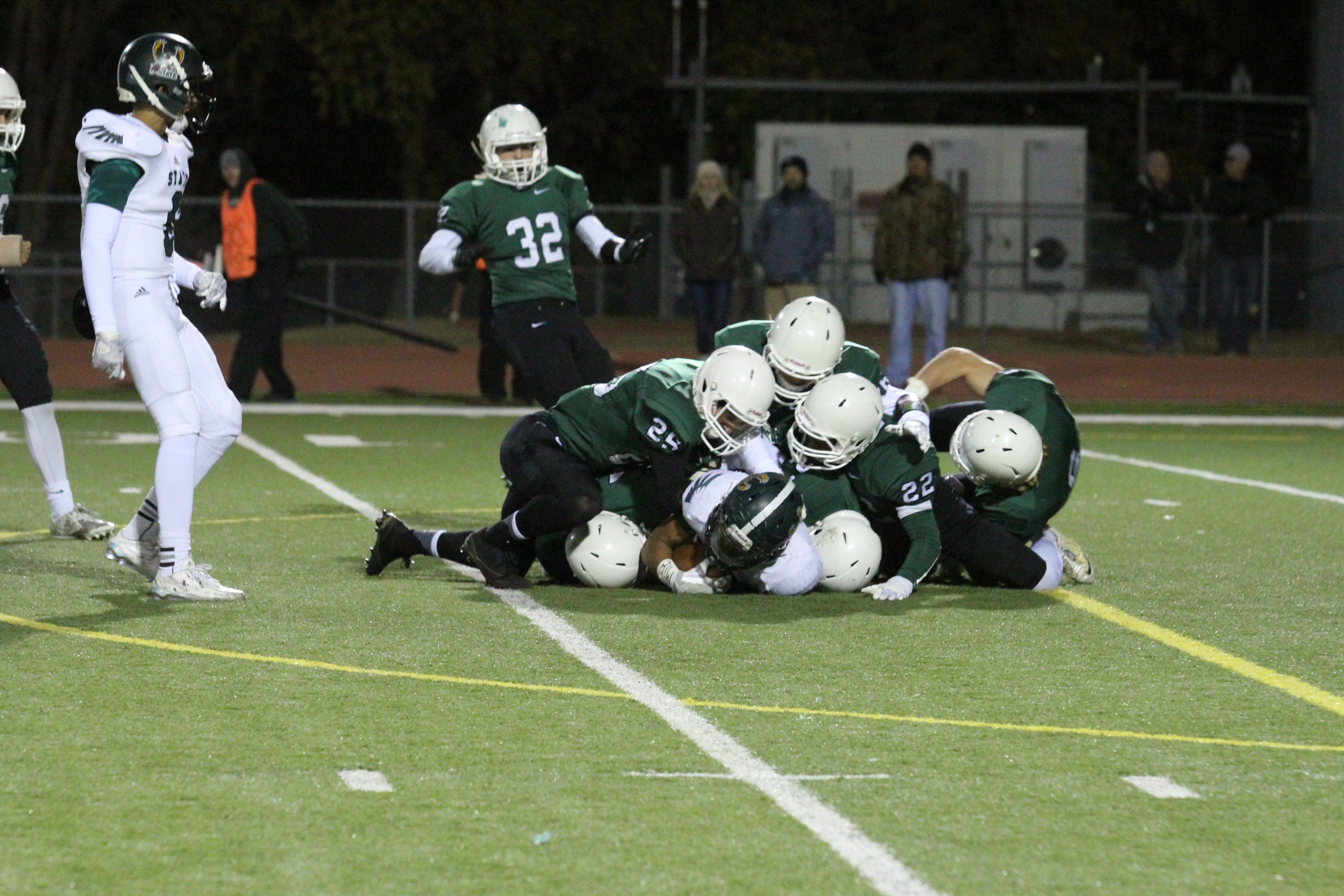 Derby's defense sacks Lawrence free state QB in their sub-state game.